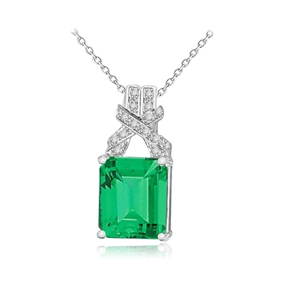 7-carat emerald-cut emerald pendant in Whilte Gold