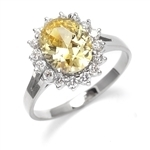 Light your fire with this Cocktail Ring,3 cts. Oval cut Canary Diamond Essence Center and accents encircling the fireworks! 3.5 Cts. T.W. set in 14K Solid White Gold.