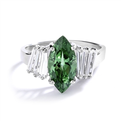 Erin - 1.5 Cts. Marquise Cut Emerald Essence is shining bright in center, accompanied by 3 Baguettes on each side. In 14k Solid White Gold.