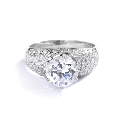 Heirloom - Brilliant Ring with 3 Cts. Round Diamond Essence Store atoning a fanfare band of Pave Set Melee Stones on each side. 3.25 Cts. T.W. set in 14K Solid White Gold.