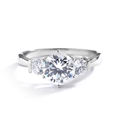 14K Solid White Gold ring features a 2.0 ct. round cut Diamond Essence centerpiece rubbing elbows with two 0.3 round cut masterpices beside it. 2.6 cts. T.W. Breeding shows.