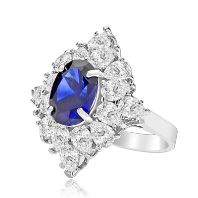 Designer ring with 3.5 Ct. oval Sapphire Essence set in four prongs, and surrounded by pear cut diamond essence stones in floral pattern. 8.5 Cts. T.W. et in 14K Solid White Gold.
