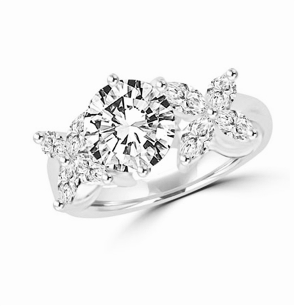 "Unusual Ring with a 2.0 Ct. Round Brilliant cut Diamond Essence center stone supported by a vibrant ""X"" on each side with 8 Marquise Cut Masterpieces. 3.2 Cts. T.W, in 14K Solid White Gold."