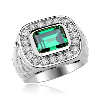 Imposing 14K Solid Whit Gold, Man's ring with a 4.0 ct. bezel-set Emerald cut Emerald center stone attended by a melee of Round cut mini masterpieces. 4.5 cts. t.w. For prime movers.
