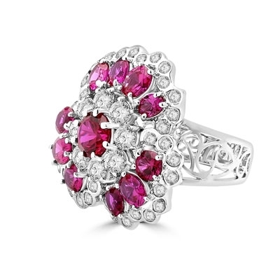 A beautiful ring in floral design. Diamond Essence ruby and round brilliant masterpieces.5.0 cts. T.W. set in 14K Solid White Gold. A perfect party wear to get compliments.