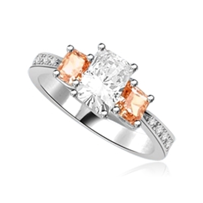Ring-emerald cut stone with champagne baguettes
