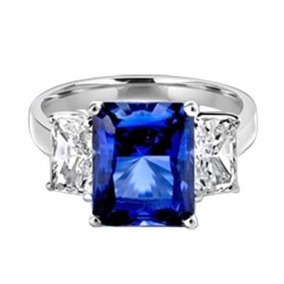 Sapphire Ring - 4.0 Cts. Radiant Emerald cut Saphhire Essence in center accompanied by Radiant Emerald cut Diamond Essence on sides. 5.0 Cts. T.W. set in 14K Solid White Gold.