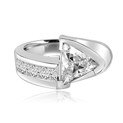 Meet the Star! Graduating Diamond Essence Brilliants ascend to kiss the beauty of shining 4 Cts. Trilliant set exquisitely on channels forming a design to behold. 4.75 Cts. T.W. set in 14K Solid White Gold.