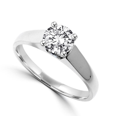 Smart Solitaire Ring with 0.75 Cts. Round Brilliant Masterpiece set perfectly on a tapering wide band. In 14k Solid White Gold.