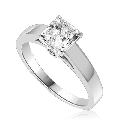 Diamond Essence Asscher cut Solitaire Ring artistically set in a wide band with a beautiful accent on both sides to enhance the looks. 1 ct.t.w. in 14K Solid White Gold.