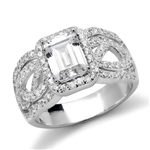 Diamond Essence Designer Ring With 1.50 Cts. Emerald Cut Diamond Essence Center Surrounded By Melee And Exquisitely Set Round Brilliant Melee On Both The Sides Of Band, 2.50 Cts.T.W., in 14K Solid White Gold.