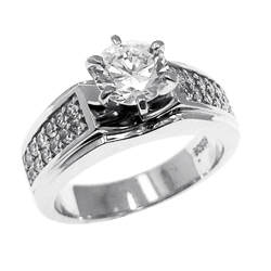 Diamond Essence Ring With 1 Ct. Round Brilliant Center Set in Six Prong Setting and Sparkling Melee on The Band Enhance the look in 14K White Gold,1.25 Cts.T.W.