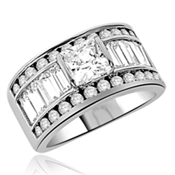 Diamond Essence Designer Ring With Princess Stone and ablaze with Baguettes and Melee, 5 Cts.T.W. set in 14K White Gold.