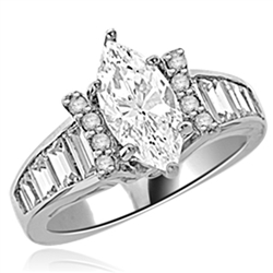 Diamond Essence Designer Ring With Marquise cut Diamond Essence, 1.50 Cts set in six prongs and Diamond Essence Melee on two sides on curved bars,The band is enhanced with Diamond Essence baguettes, 3.50 Cts.T.W. in 14K White Gold.