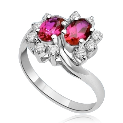 Two Ruby Oval Essence, 0.5 ct. each, set in four prongs and surrounded by melee to give floral effect. 1.20 cts. t.w. In 14k Solid White Gold.