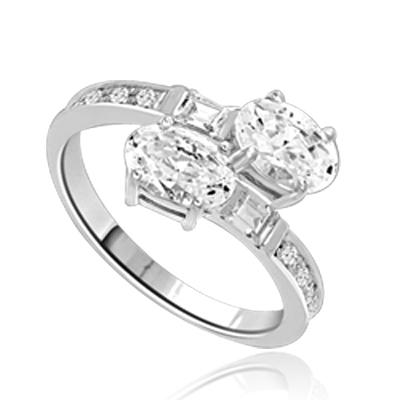 Two  Oval Essence, 1.0 ct. each, set in four prongs and accompanied by baguettes and melee on band. 2.5 Cts. T.w. In 14k Solid White Gold.