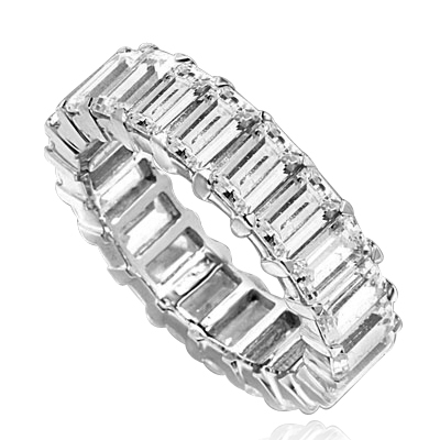 Diamond Essence Best selling eternity band with all round sparkle of emerald cut brilliant stones. 9 Cts. T.W. set in 14K Solid White Gold.