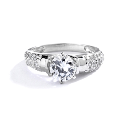 Engagement Ring- Tiffany set, 1.0 Ct Round Brilliant Diamond Essence in center with cluster of sparkling Melee on the band. 1.25 Cts T.W. set in 14K Solid White Gold.