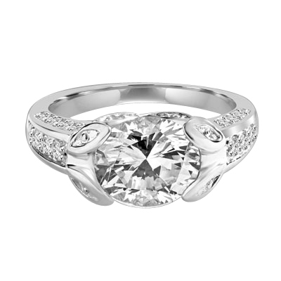 Designer Ring with 3.0 Cts. Round Brilliant Diamond Essence, artistically set in leaf shaped prongs in center, set off by Melee on either side of the band. 4.0 Cts. T.W. set in 14K Solid White Gold.