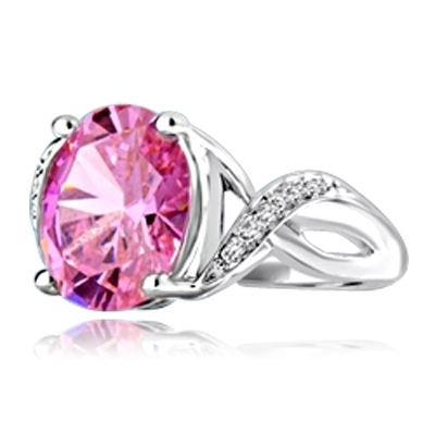 Diamond Essence Designer Ring with 5.0 Cts. Pink Oval in center, accompanied by melee on band, 5.65 Cts.T.W. set in 14K Solid White Gold.