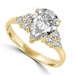 Blinding Beauty - She'll adore this outsized 2 Ct. Pear Shaped white Brilliant Diamond Essence masterpiece set with 3 dazzling round stones on either side of the band. Outstanding value for 2.30 Cts. T.W. in Gold Vermeil.