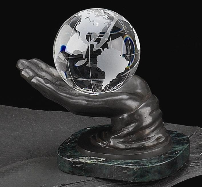 solid glass balls decorative.htm crystal globe in hand on marble base from decorative bookends com  crystal globe in hand on marble base