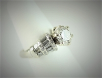 Solitaire with Tapered Baguettes and Round Diamond Band