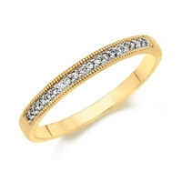 1/10ct diamond wedding band in 14K yellow gold