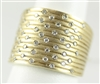 Textured wide gold tapered band with 1/2ct total weight of  diamonds in 14K yellow gold.