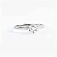 Round .36ct diamond solitaire engagement ring.