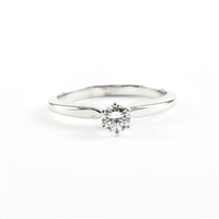 Round .31ct diamond solitaire engagement ring.
