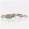 Two tone 14K white and rose gold wedding set with .90carat total diamond weight.