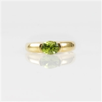 Peridot and diamond ring in 14K yellow gold.