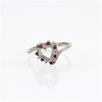 Ruby and diamond heart ring in 10K white gold.