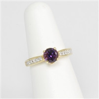 Lovely channel set princess cut diamonds highlight a round rich purple amethyst in 18K yellow gold.  Highlighted with a round brilliant cut diamond tucked away on the sides.  