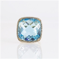 33 carat blue topaz ring with diamonds in 14K yellow gold.