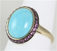 LARGE TURQUOISE STONE IN LADIES RING, HALO OF RHODOLITE GARNETS