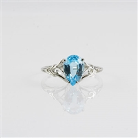 Pear shape blue topaz in 14K white gold ring.