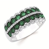 Emerald and diamond ring in 14K white gold.  Diamond weight .33ct. total weight.