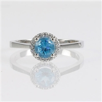 Round brilliant cut blue topaz & diamond ring.