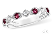 Ruby and diamond band in 14K white gold.