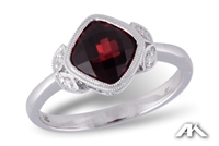 Garnet and diamond ring in 14K white gold.