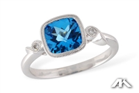 Blue topaz and diamond ring in 14K white gold.