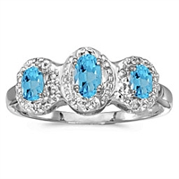 Three stone blue topaz and diamond ring in 14K white gold.
