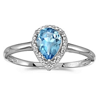 Pear shape blue topaz and diamond ring in 14K gold.