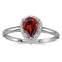 Pear shape garnet and diamond ring in 14K gold.