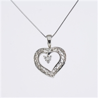 Diamond heart pendant in 14K white gold.