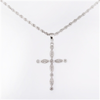 Cross in 14K white gold with .07ct tw diamond.
