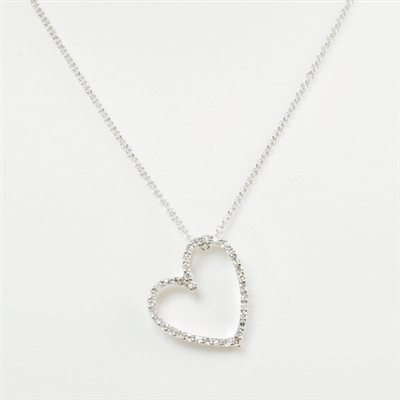 Diamond heart necklace sparkling with diamonds. Not the usual heart, this one has a little quirkiness that you'll love.