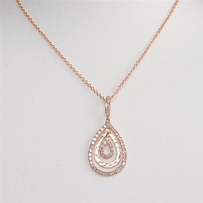 "Diamond teardrop pendant  presented in 14K rose gold features .17 ct total diamond weight suspended from 18"" 14K rose gold chain."